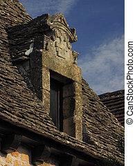 Roof, window, sculpture
