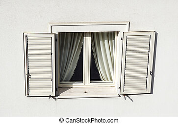 Roof window with roller shutter . detail of building