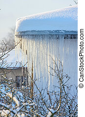 Roof with icicles hanging from roof.
