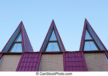 Roof with metal tile
