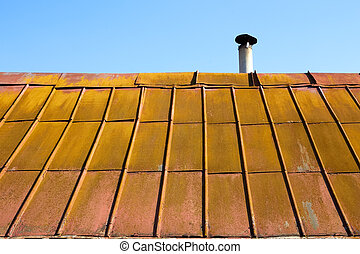 Roof with old metal tile