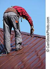 roofer builder worker on roof