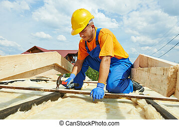 Roofer carpenter works on roof