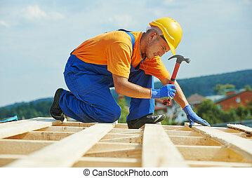 Roofer carpenter works on roof - construction roofer...