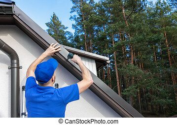 roofer installing metal drip edge profile on the house roof