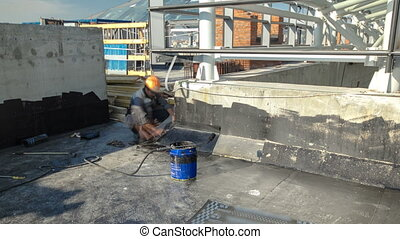 Roofer installing Roofing felt with heating and melting of bitumen roll by torch on flame during roof repair timelapse