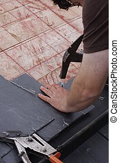 roofer made a roof with slates