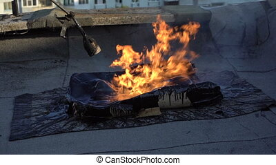 Roofer melts the bitumen - Employee melt bitumen gas burner....