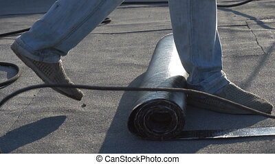 Roofer melts the bitumen