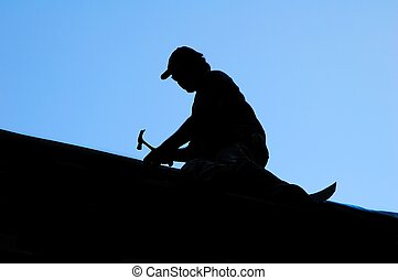 Silhouette of roofer with hammer