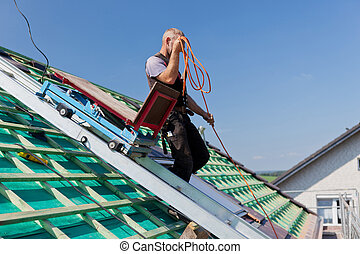 Roofer using the elevator - Roofer using the construction...