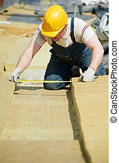 roofer worker measuring insulation material - builder worker...