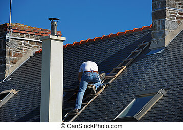 Roofer working next to the chimney