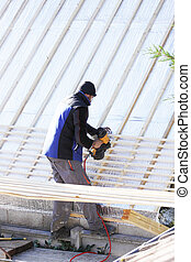 roofer working on a new roof in wood