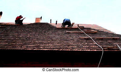 Roofers working on the roof