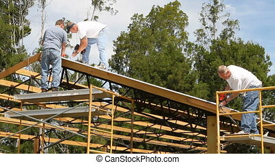 Roofing Crew Construction - Construction crew use powered...