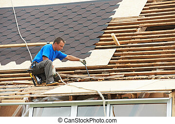 roofing work with flex roof - worker on roof at works with ...