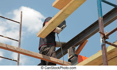 Roofing works - welder on scaffold