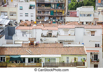 Roofs of Barcelona. Piece of the city of Barcelona seen from above shows architecture of a general air view in a summer day. Cityscape of rooftops in the L'Eixample district. Catalonia, Spain.