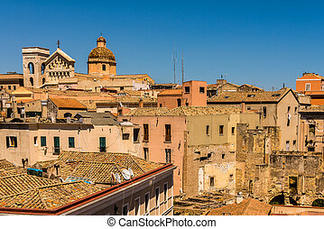 Cagliari - capital of Sardinia. Sardegna wide angle view. Roofs and houses of biggest city in Sardinia island - Cagliari, Italy. Old town center.
