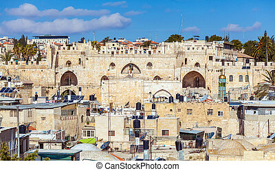 Roofs of Old City with ancient wall gates, Jerusalem