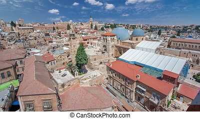 Roofs of Old City with Holy Sepulcher Church Dome timelapse, Jerusalem, Israel. Top view with blue cloudy sky