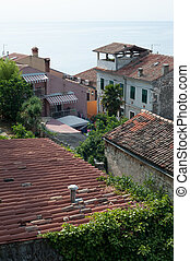 Roofs of old town with Mediterranean sea in the background