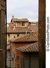 Roofs of the buildings of the Siena street, Italy