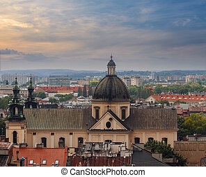 Roofs of the houses and the church in evening time