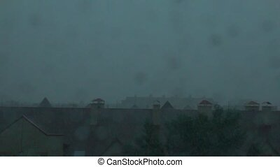 Roofs of town houses in the thunderstorm. Slow motion video of lightning