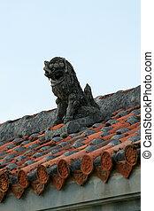 Rooftop Guardian Statue - Taketomi Island , Okinawa, Japan