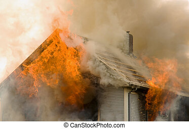 Rooftop house fire - Flames shoot out of an upper story and...
