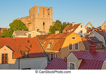 Rooftops and a medieval fortress in Visby, capital of Gotland, Sweden.