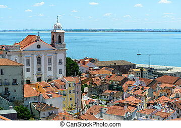 Rooftops and church of Santo Estevao, Lisbon (Portugal) -...