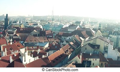 Rooftops and narrow streets of famous Old town in Prague, Czech Republic. 4K pan establishing shot