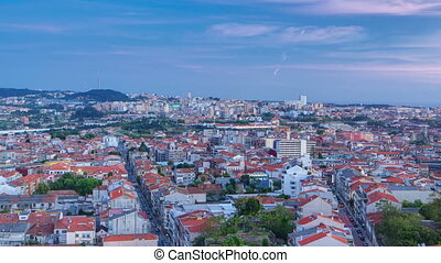 Rooftops of Porto's old town on a warm spring day timelapse day to night, Porto, Portugal