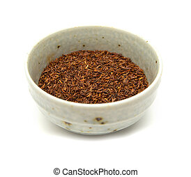 Rooibos tea, dry fermented leaves isolated on white...