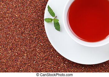 Rooibos Tea with lemon balm - Rooibos Tea in a cup with lots...