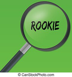 ROOKIE text under a magnifying glass on green background. ...