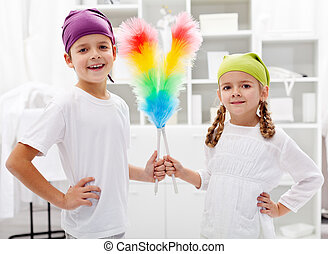 Room cleaning taskforce - kids with dust brushes preparing to tidy up