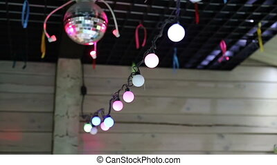 Room decoration, garland on the ceiling and rotating mirror ball
