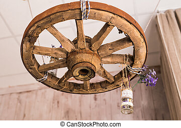room interior in style a rustic with vintage wheel