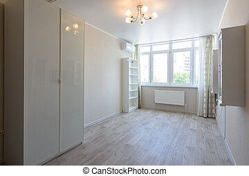 Room interior with wardrobe and hanging cupboards