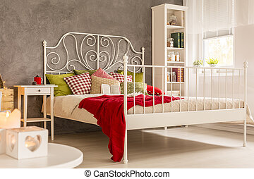 Room with bed and bookcase