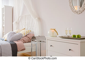 Room with bed with canopy