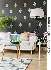 Room with black wall with colourful diamonds