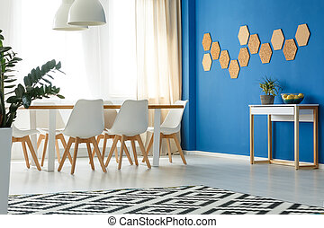 Room with blue wall accent - Blue wall accent in minimalist...