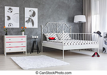Room with dresser and bed