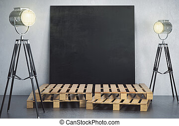 Room with empty chalkboard poster and lighting