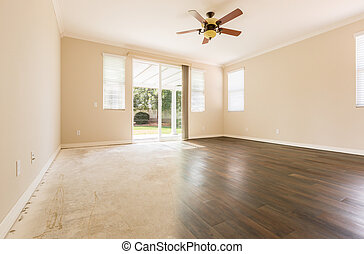 Room with Gradation from Cement to Hardwood Flooring